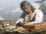 Javier inspects his gun